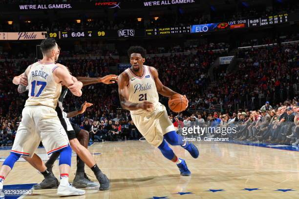 Joel Embiid of the Philadelphia 76ers drives to the basket against the Brooklyn Nets at the Wells Fargo Center on March 16 2018 in Philadelphia...