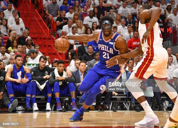 Joel Embiid of the Philadelphia 76ers drives to the basket against the Miami Heat in the first quarter during Game Four of Round One of the 2018 NBA...
