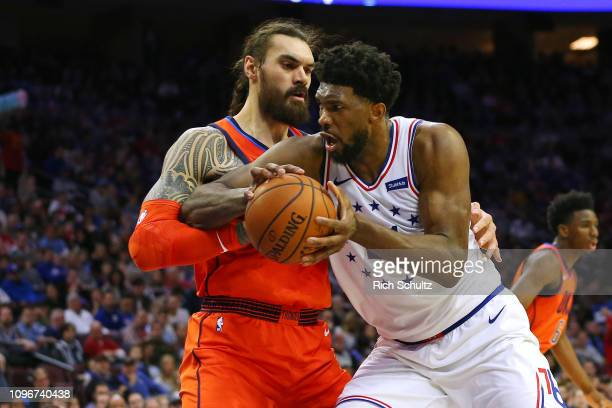 Joel Embiid of the Philadelphia 76ers drives to the basket as Steven Adams of the Oklahoma City Thunder defends during the first half of a game at...