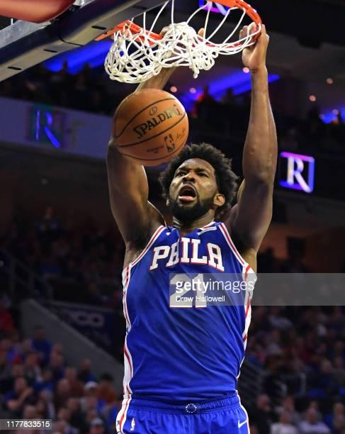 Joel Embiid of the Philadelphia 76ers dunks against the Boston Celtics at Wells Fargo Center on October 23 2019 in Philadelphia Pennsylvania The...