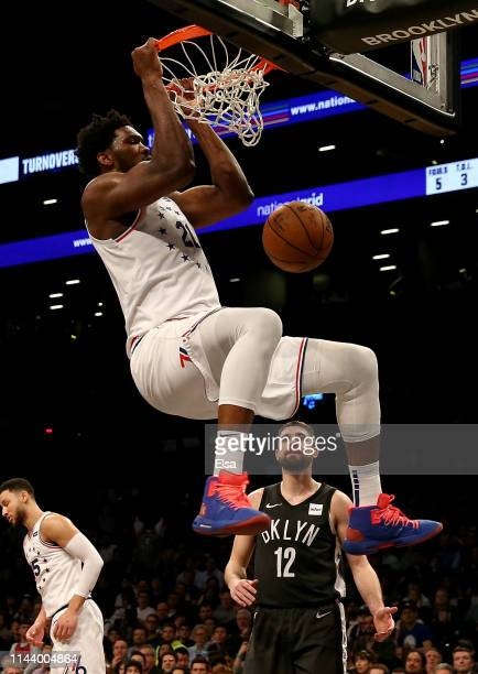 Joel Embiid of the Philadelphia 76ers dunks in the second half against the Brooklyn Nets at Barclays Center on April 20 2019 in the Brooklyn borough...