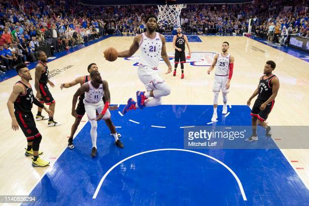 Joel Embiid of the Philadelphia 76ers dunks the ball against the Toronto Raptors in the fourth quarter of Game Three of the Eastern Conference...