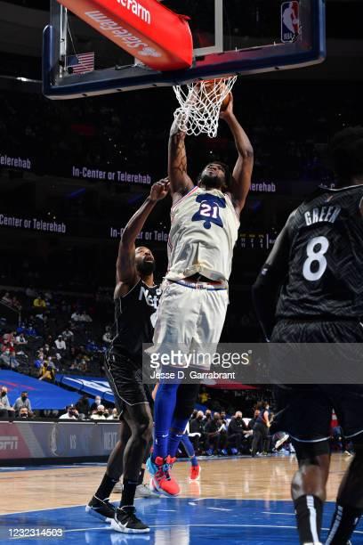 Joel Embiid of the Philadelphia 76ers dunks the ball against the Brooklyn Nets on April 14, 2021 at Wells Fargo Center in Philadelphia, Pennsylvania....