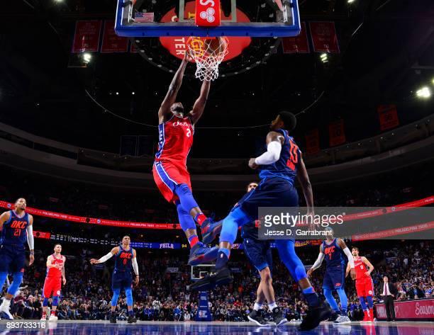 Joel Embiid of the Philadelphia 76ers dunks the ball against the Oklahoma City Thunder at Wells Fargo Center on December 15 2017 in Philadelphia...