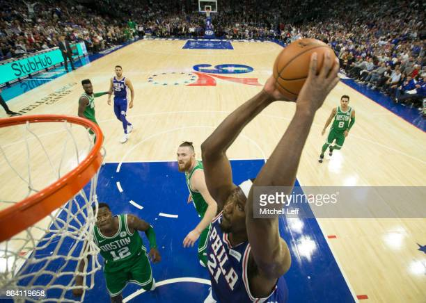 Joel Embiid of the Philadelphia 76ers dunks the ball past Terry Rozier and Aron Baynes of the Boston Celtics in the third quarter at the Wells Fargo...