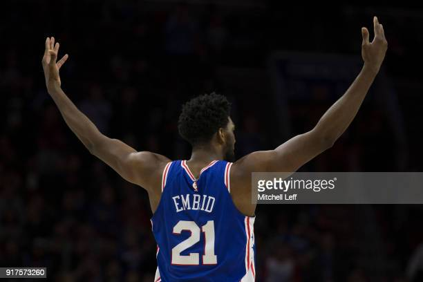 Joel Embiid of the Philadelphia 76ers encourages the crowd to get loud in the third quarter against the New York Knicks at the Wells Fargo Center on...