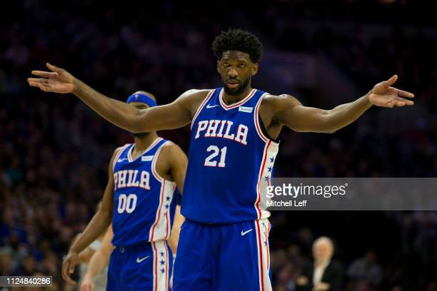 Joel Embiid of the Philadelphia 76ers encourages the crowd to get loud against the San Antonio Spurs at the Wells Fargo Center on January 23 2019 in...