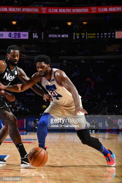 Joel Embiid of the Philadelphia 76ers fights for the ball against the Brooklyn Nets on April 14, 2021 at Wells Fargo Center in Philadelphia,...
