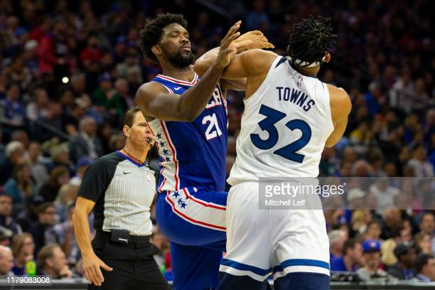 Joel Embiid of the Philadelphia 76ers fights with KarlAnthony Towns of the Minnesota Timberwolves in the third quarter at the Wells Fargo Center on...