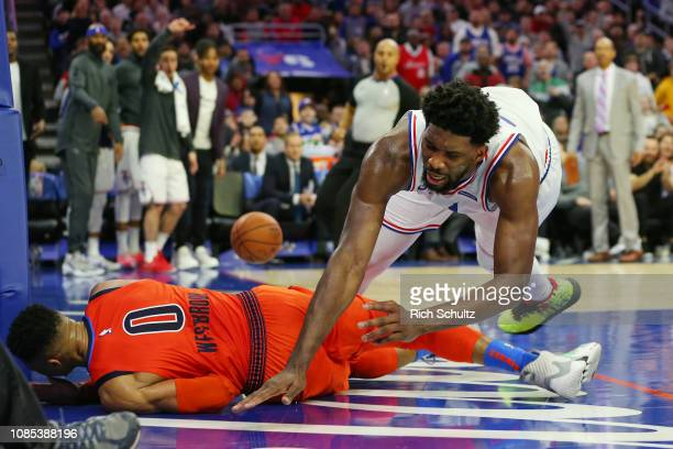 Joel Embiid of the Philadelphia 76ers fouls Russell Westbrook of the Oklahoma City Thunder during the second half of a game at Wells Fargo Center on...