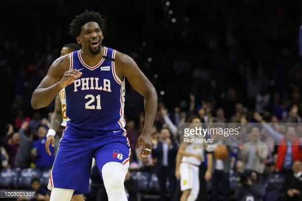 Joel Embiid of the Philadelphia 76ers gestures after scoring a three-point basket for his career high 49th point during the second half of an NBA...