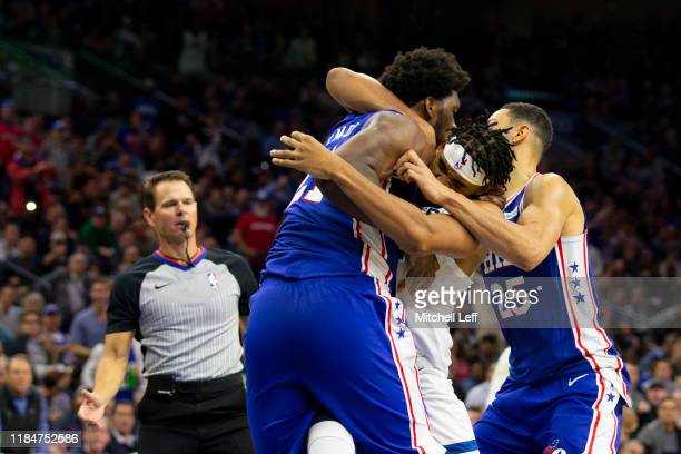 Joel Embiid of the Philadelphia 76ers gets in a fight with KarlAnthony Towns of the Minnesota Timberwolves as Ben Simmons tries to break them apart...