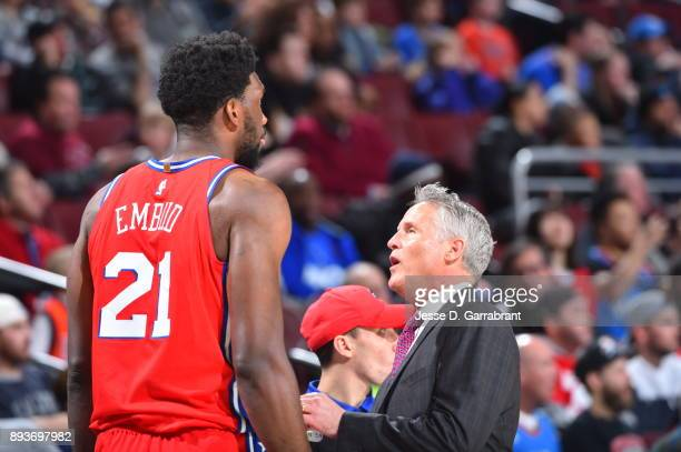 Joel Embiid of the Philadelphia 76ers gets instruction from Head Coach Brett Brown against the Oklahoma City Thunder at Wells Fargo Center on...