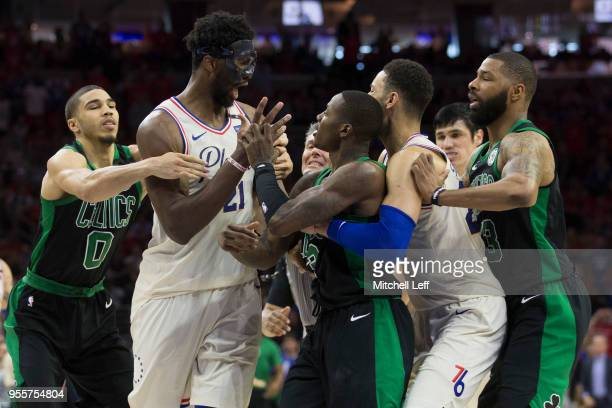Joel Embiid of the Philadelphia 76ers gets into an altercation with Terry Rozier of the Boston Celtics as Jayson Tatum and Marcus Morris of the...