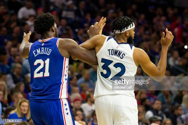 Joel Embiid of the Philadelphia 76ers gets tangled up with KarlAnthony Towns of the Minnesota Timberwolves in the third quarter at the Wells Fargo...
