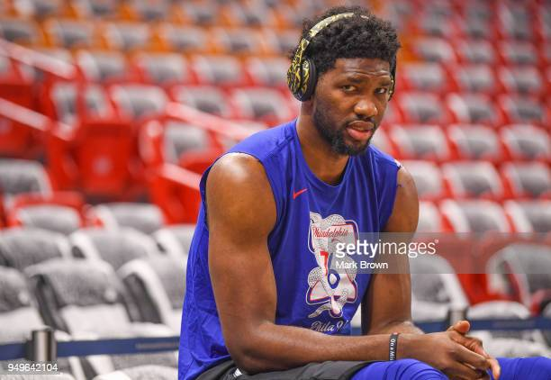 Joel Embiid of the Philadelphia 76ers getting stretched before Game Four of Round One of the 2018 NBA Playoffs against the Miami Heat at American...