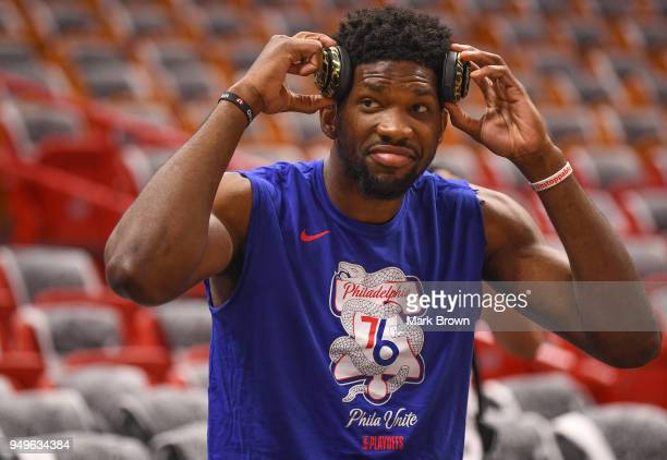 Joel Embiid of the Philadelphia 76ers getting stretched before the game against the Miami Heat at American Airlines Arena on April 21 2018 in Miami...