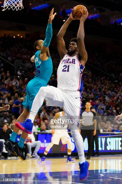 Joel Embiid of the Philadelphia 76ers goes up for a dunk against PJ Washington of the Charlotte Hornets in the second quarter at the Wells Fargo...