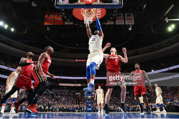 Joel Embiid of the Philadelphia 76ers goes up for a dunk against the Miami Heat in Game Five of Round One of the 2018 NBA Playoffs on April 24 2018...
