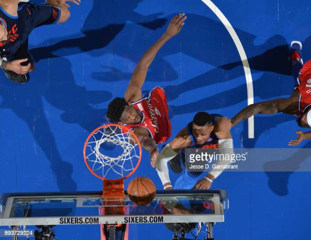 Joel Embiid of the Philadelphia 76ers goes up for the blocked shot against the Oklahoma City Thunder at Wells Fargo Center on December 15 2017 in...