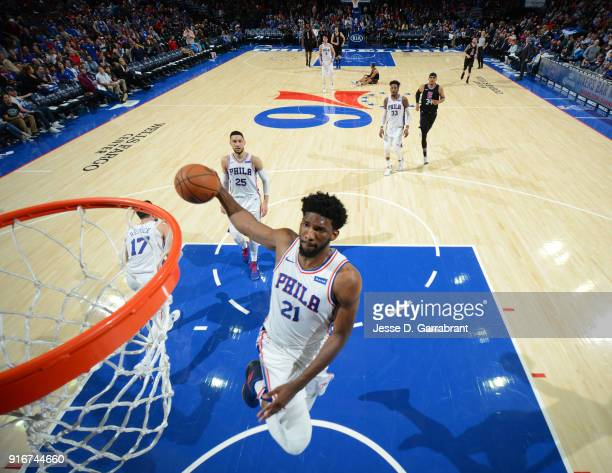 Joel Embiid of the Philadelphia 76ers goes up for the dunk against the Los Angeles Clippers at Wells Fargo Center on February 10 2018 in Philadelphia...