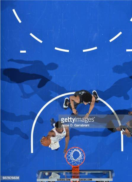 Joel Embiid of the Philadelphia 76ers goes up for the dunk against the Brooklyn Nets at the Wells Fargo Center on March 16 2018 in Philadelphia...
