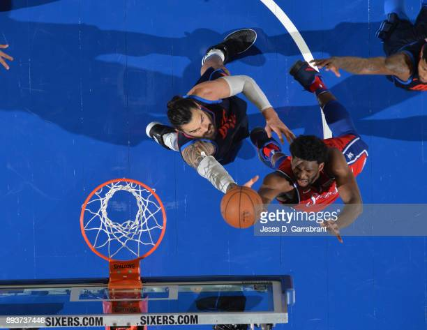 Joel Embiid of the Philadelphia 76ers goes up for the layup against the Oklahoma City Thunder at Wells Fargo Center on December 15 2017 in...