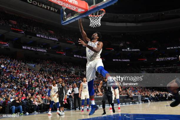 Joel Embiid of the Philadelphia 76ers goes up for the layup against the Brooklyn Nets at the Wells Fargo Center on March 16 2018 in Philadelphia...