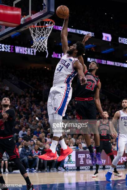 Joel Embiid of the Philadelphia 76ers goes up the dunk the ball against Thaddeus Young of the Chicago Bulls at the Wells Fargo Center on February 9,...