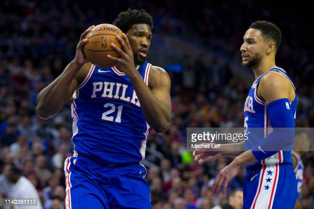 Joel Embiid of the Philadelphia 76ers grabs a rebound in front of Ben Simmons against the Brooklyn Nets in Game Two of Round One of the 2019 NBA...