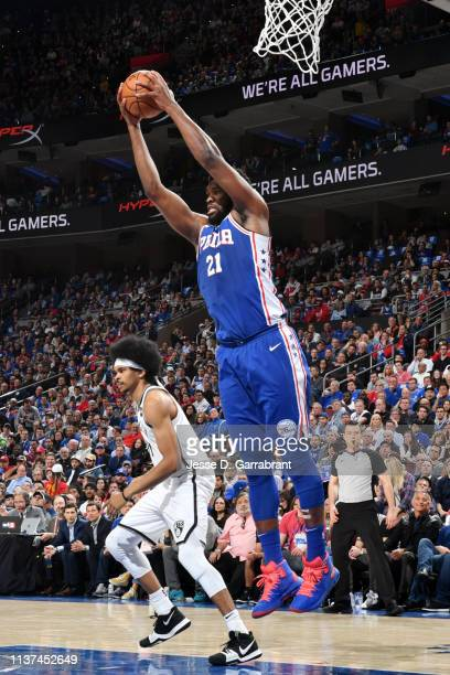Joel Embiid of the Philadelphia 76ers grabs the rebound against the Brooklyn Nets during Game Two of Round One of the 2019 NBA Playoffs on April 15...