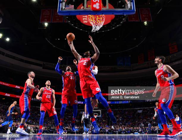 Joel Embiid of the Philadelphia 76ers grabs the rebound against the Oklahoma City Thunder at Wells Fargo Center on December 15 2017 in Philadelphia...