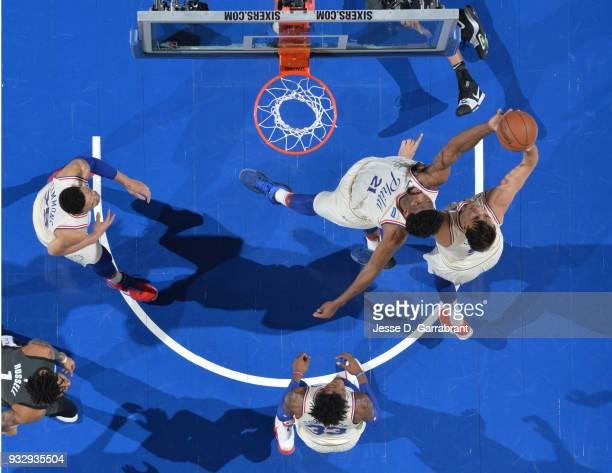 Joel Embiid of the Philadelphia 76ers grabs the rebound against the Brooklyn Nets at the Wells Fargo Center on March 16 2018 in Philadelphia...