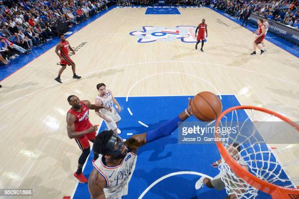 Joel Embiid of the Philadelphia 76ers grabs the rebound against the Miami Heat in Game Five of Round One of the 2018 NBA Playoffs on April 24 2018 at...