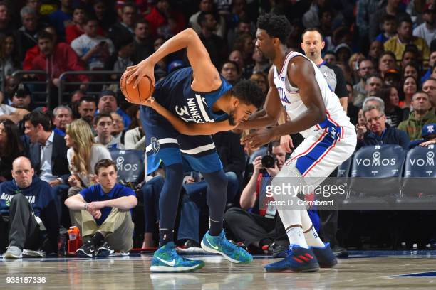 Joel Embiid of the Philadelphia 76ers guards KarlAnthony Towns of the Minnesota Timberwolves on March 24 2018 in Philadelphia Pennsylvania at the...