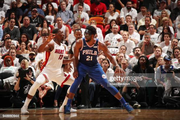 Joel Embiid of the Philadelphia 76ers handles the ball against Bam Adebayo of the Miami Heat in Game Three of Round One of the 2018 NBA Playoffs on...