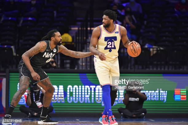 Joel Embiid of the Philadelphia 76ers handles the ball against DeAndre Jordan of the Brooklyn Nets on April 14, 2021 at Wells Fargo Center in...