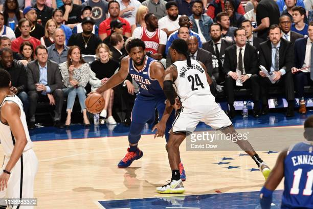 Joel Embiid of the Philadelphia 76ers handles the ball against Rondae HollisJefferson of the Brooklyn Nets during Round One Game Five of the 2019 NBA...
