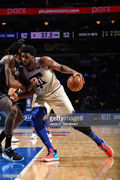 Joel Embiid of the Philadelphia 76ers handles the ball against the Brooklyn Nets on April 14, 2021 at Wells Fargo Center in Philadelphia,...