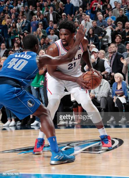 Joel Embiid of the Philadelphia 76ers handles the ball against the Dallas Mavericks on October 28 2017 at the American Airlines Center in Dallas...