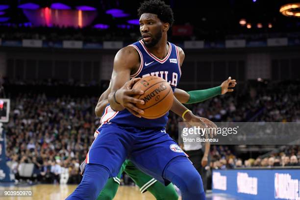 Joel Embiid of the Philadelphia 76ers handles the ball against the Boston Celtics as a part of the 2018 NBA London Game at the 02 Arena on January 11...