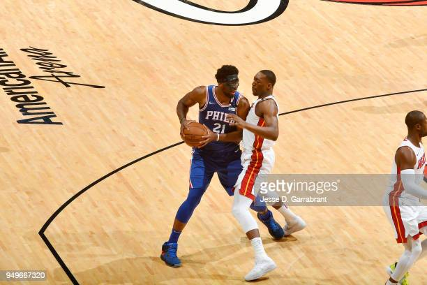 Joel Embiid of the Philadelphia 76ers handles the ball against the Miami Heat in Game Four of Round One of the 2018 NBA Playoffs on April 21 2018 at...