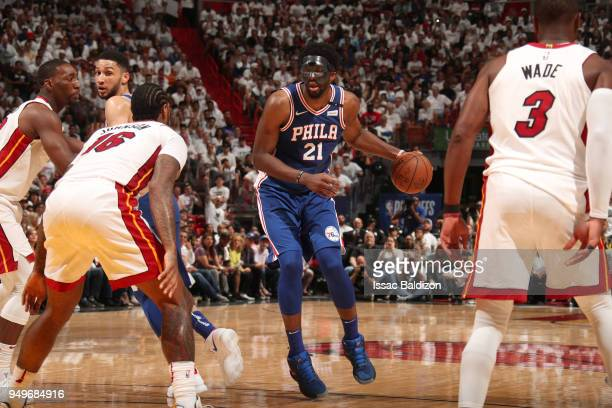 Joel Embiid of the Philadelphia 76ers handles the ball against the Miami Heat in Game Four of the Eastern Conference Quarterfinals during the 2018...