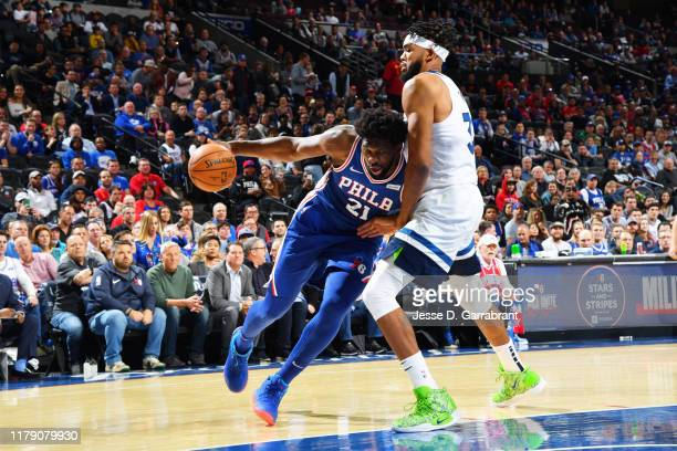Joel Embiid of the Philadelphia 76ers handles the ball against KarlAnthony Towns of the Minnesota Timberwolves on October 30 2019 at the Wells Fargo...