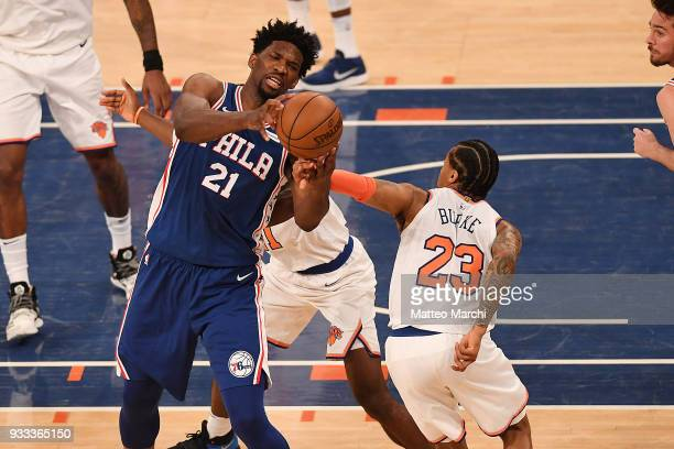 Joel Embiid of the Philadelphia 76ers handles the ball against Trey Burke of the New York Knicks during the game at Madison Square Garden on March 15...