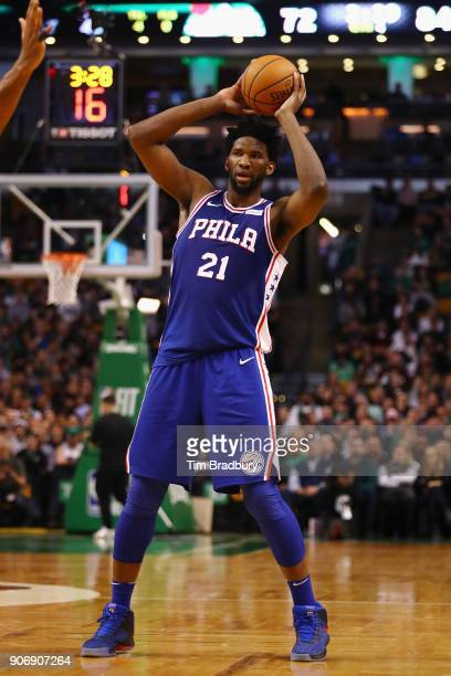 Joel Embiid of the Philadelphia 76ers handles the ball during the second half against the Boston Celtics at TD Garden on January 18 2018 in Boston...