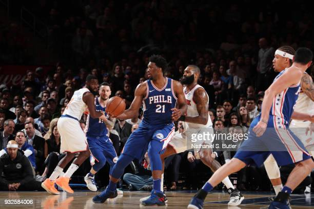 Joel Embiid of the Philadelphia 76ers handles the ball during the game against the New York Knicks on March 15 2018 at Madison Square Garden in New...