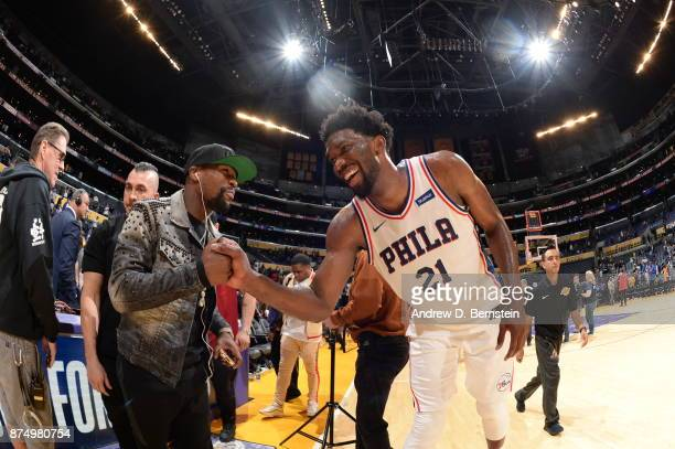 Joel Embiid of the Philadelphia 76ers high fives Floyd Mayweather Jr on November 15 2017 at STAPLES Center in Los Angeles California NOTE TO USER...