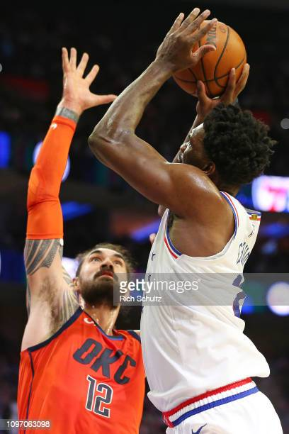 Joel Embiid of the Philadelphia 76ers in action against Steven Adams of the Oklahoma City Thunder during a game at Wells Fargo Center on January 19...