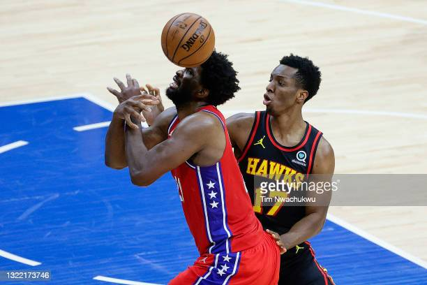 Joel Embiid of the Philadelphia 76ers is fouled by Onyeka Okongwu of the Atlanta Hawks during the second quarter during Game One of the Eastern...